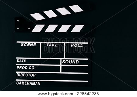 Movie Clapper Board. Black Wooden Clapperboard On Dark Background With Copy Space, Close-up. Cinema