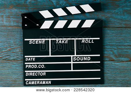 Movie Clapper Board. Black Clapperboard On Blue Wooden Background With Copy Space, Close-up. Cinema