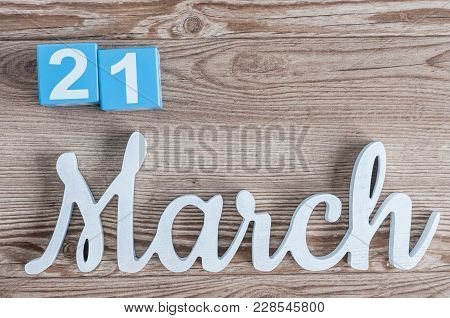 March 21st. Day 21 Of March Month, Daily Calendar On Wooden Table Background With Carved Text. Sprin
