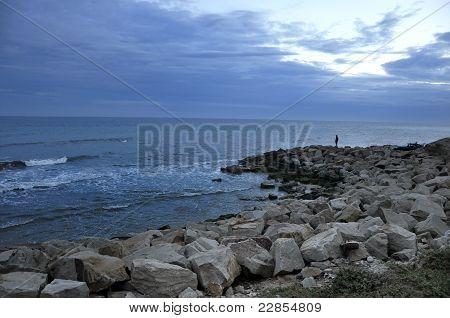 Ocean view, nice sky and rock pier.