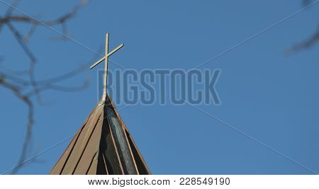 Left Focus Cross On Church Steeple Blue Sky Background