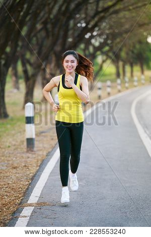 Beautiful Fitness Woman Running In Park