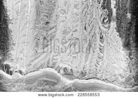 Frosted Window With Intricate Patterns In The Icy Rime