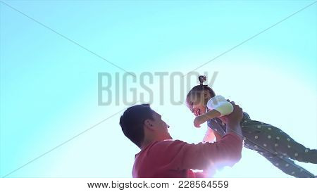 Father And Daughter Against Sky. Father And Child Playing At Sunset Light On Field Nature. Father Wi