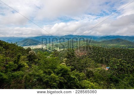 Mountains Range View Behind The Mist Of Forest And Tree, Northern Of Thailand In Winter