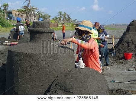 Kaohsiung, Taiwan -- August 5, 2017: Artists Work On Sand Sculptures At The 2017 Black Sand Beach Fe