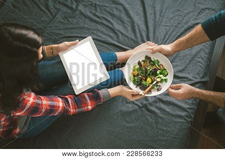 Love And Care Concept. Man Brought A Salad In Bed To His Beloved Woman