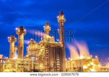 Oil And Gas Industry,refinery Factory,petrochemical Plant Area At Sunrise With Cloudy Sky