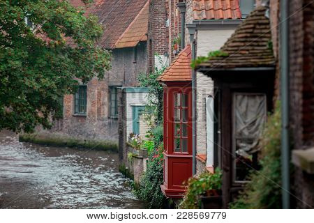 Old Houses Near River In Brugge, Belgium