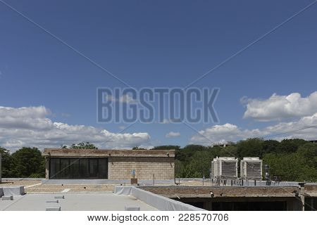 Roof With Conditioner And Blue Sky. Industrial Air Conditioning And Ventilation Systems On A Roof.
