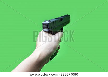 Hand Hold Gun On Green Screen