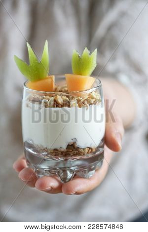 Fresh Fruit Parfait With Yogurt And Granola, Carrot Shape Melon And Kiwi For Easter Breakfast