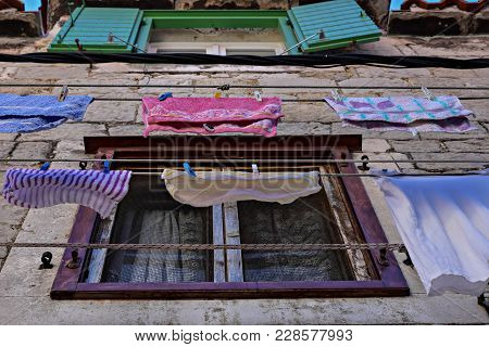Typical Dalmatian/ Mediterranean Scene Of Colorful Clothes Laundry Drying Outdoor Under Sun And Open