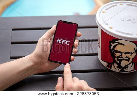 Koh Samui, Thailand - January 19, 2018: Man Hands Holding Iphone X With App Kentucky Fried Chicken.