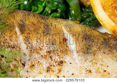 Baked Dorado Fish. Macro. Photo Can Be Used As A Whole Background.