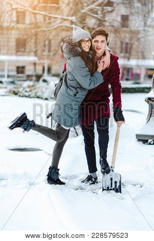Young Couple In Love Outdoor Winter. Winter. A Park.