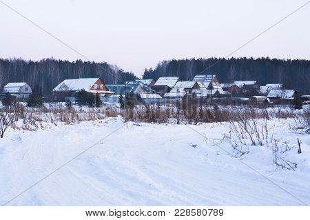 Private Houses In The Russian Village In Winter