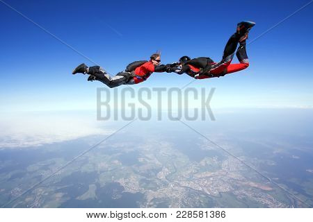 Skydive Couple Flying Together In The Air