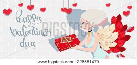Holiday Card To The Day Of Saint Valentine With Cupid Girl  Which Holds The Gift In The Box. Vector