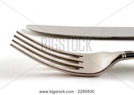 Fork And Knife In White Background