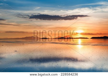 Mirror Surface On The Salt Flat Salar De Uyuni At Sunset, Altiplano, Bolivia