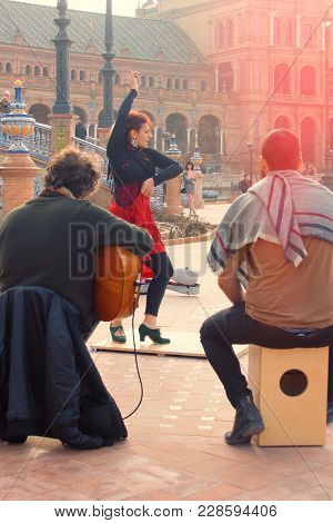A Group Of Flamenco Performers Dance And Sing In Plaza De España.spain, Seville, February 2018