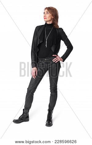 Full Length Of Middle Aged Woman In Leather Clothes