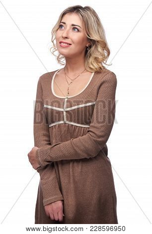 Smiling Blonde Woman In Casual Brown Dress