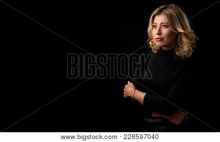 Woman With Fair Hair Wearing Turtle Neck Shirt