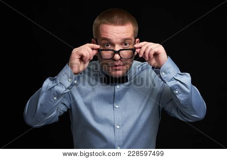 Surprised Guy Dresssed Casually Wearing Spectacles
