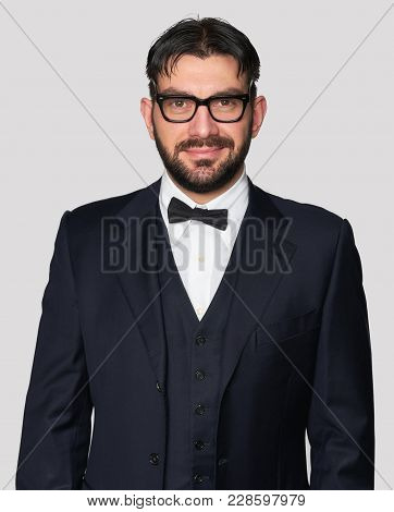 Happy Handsome Man Wearing Classic Suit And Bow Tie
