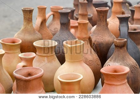 Many Clay Jugs On A Bargain Sale.