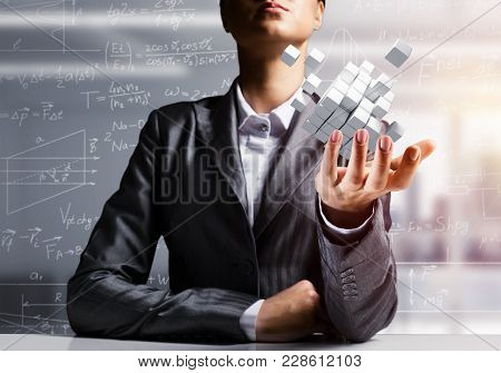 Cropped Image Of Business Woman In Suit Presenting Multiple Cubes In Hand As Symbol Of Innovations.