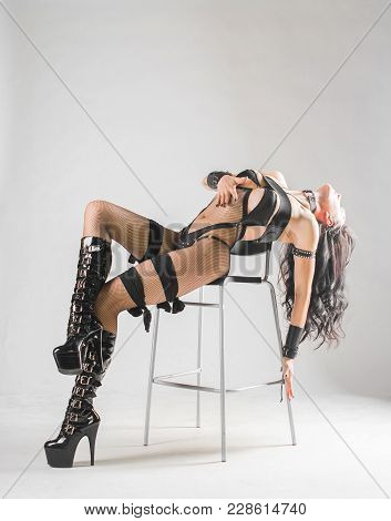 Beautiful Sexy Woman Sitting On Chair In Lingerie: Bdsm And Fetish Theme.