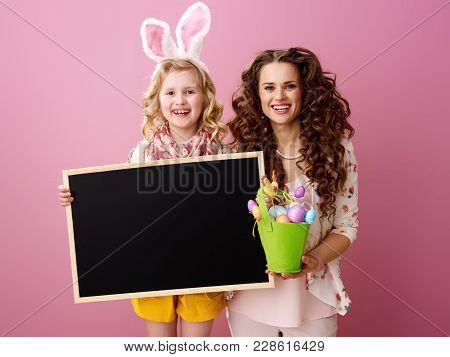 Mother And Child With Easter Eggs Bucket Showing Blank Board