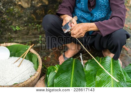 Old Woman Hands Preparing To Make Chung Cake, The Vietnamese Lunar New Year Tet Food