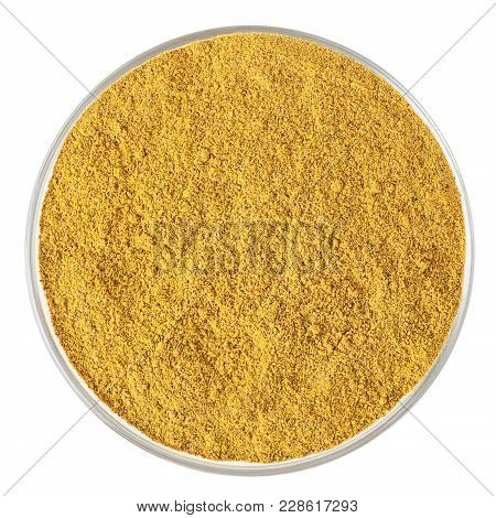 Curry Powder In Glass Bowl Isolated On White Background With Clipping Path