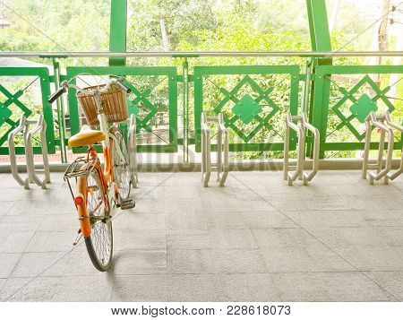 Bicycle Locked To Public Bicycle Parking Rack Or Bike Rack On Pedestrian Overpass