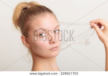 Beauty Skin Care Cosmetics And Health Concept. Closeup Young Woman Face, Girl Removing Facial Peel O