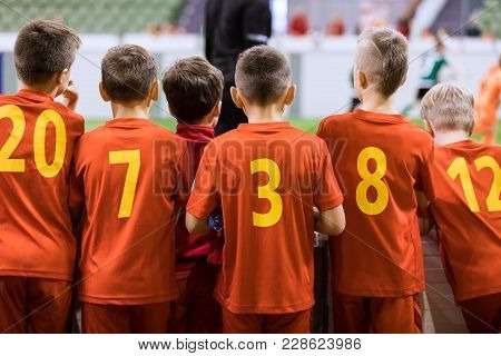 Indoor Football Team. Futsal Indoor Soccer Match For Kids. Children Supporting Teammates. Sports Are