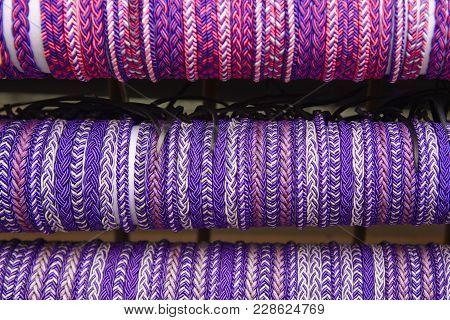 Ultra Violet Wristbands. Purple Textured Background. Hand Made. Horizontal