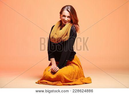 Fall. Fashion Woman In Autumn Color Fresh Girl In Full Length Long False Orange Eye-lashes