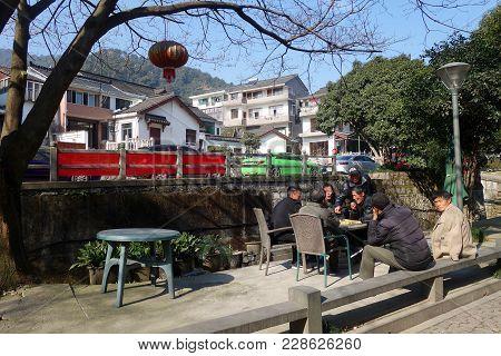 Hangzhou, China - Jan 18, 2018: Chinese People Playing Chess In The Meijiawu Village In Hangzhou. Ha