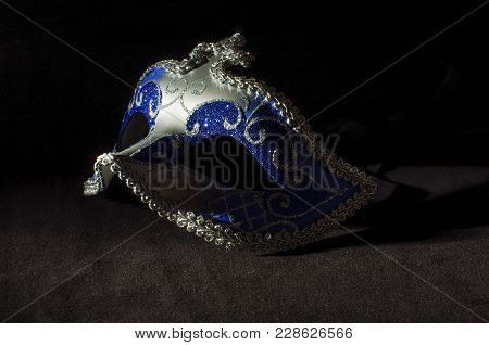 Silver Blue Domino Mask For Celebrations And Festivals On The Dark Black Background