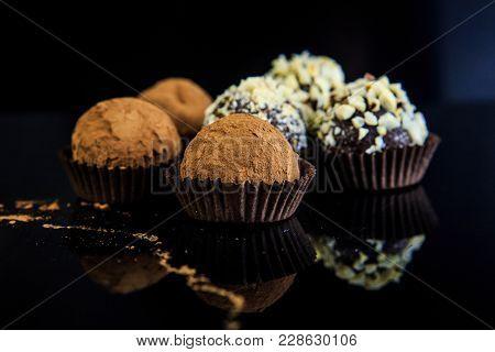 Chocolate Candies On Black Background