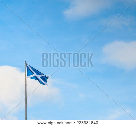 Scottish Saltire Flag And Blue Sky With Clouds