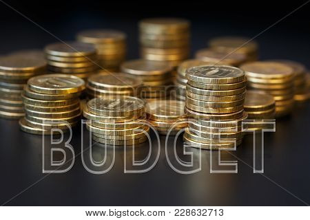 The Word Budget Is Made Up Of Transparent Letters Located On Piles Of Coins. The Concept Of Budgetin