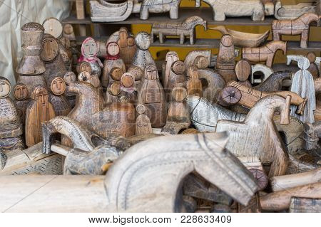 The Ancient Wooden Toys Which Are Cut Out From A Tree, Restoration Of Ancient Tradition Of A Carving