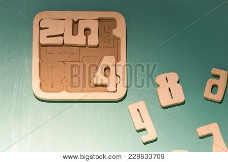 Math Game For Junior Age With Colored Wooden Signs Of Numbers. Objects