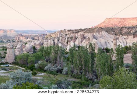 Sunset In Red Valley, Cappadocia, Turkey. Cappadocian Region With Its Valley, Canyon, Hills Located